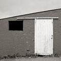Black Window and White Door, Farm Building, Lanarkshire, Scotland.